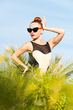 Fashion woman posing. Young cool fashion woman posing over blue sky Stock Images