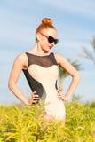 Fashion woman posing. Young cool fashion woman posing over blue sky Stock Photos