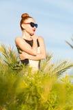 Fashion woman posing. Young cool fashion woman posing over blue sky Stock Image