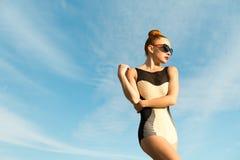 Fashion woman posing. Young cool fashion woman posing over blue sky Stock Photography