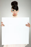 Fashion woman presenting blank board Royalty Free Stock Photos