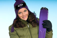 Fashion woman with purple skis Royalty Free Stock Photos