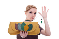 Fashion woman with purse and necklace Royalty Free Stock Photography