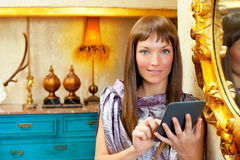 Fashion woman reading ebook tablet in grunge house Stock Images