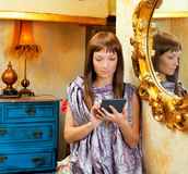 Fashion woman reading ebook tablet in grunge house Royalty Free Stock Photo