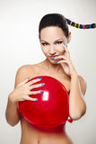 Fashion woman with a red balloon Stock Images