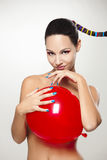 Fashion woman with a red balloon Stock Photo