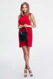 Fashion woman in red dress holding handbag Royalty Free Stock Image
