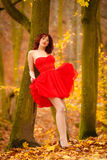 Fashion woman red dress relaxing walking in park Royalty Free Stock Photos