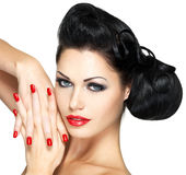 Fashion woman with red lips, nails and creative hairstyle Royalty Free Stock Image