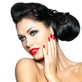 Fashion woman with red lips, nails and creative hairstyle. Beautiful fashion woman with red lips, nails and creative hairstyle - isolated on white background stock photography