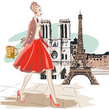 Fashion woman in red skirt walks around Paris near Eiffel Tower Royalty Free Stock Photo