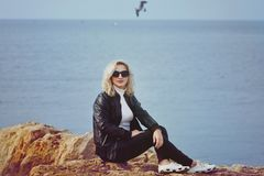 Fashion woman relaxing near the sea Stock Images