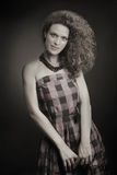 Fashion woman in retro checked dress Royalty Free Stock Image