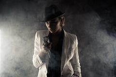 Fashion woman with retro microphone in smoke Stock Image