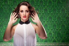 Fashion woman retro style on green vintage background Royalty Free Stock Images