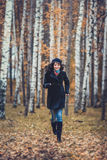 Fashion woman running in autumn park Royalty Free Stock Photos