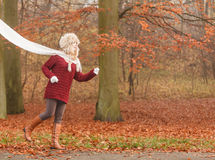 Fashion woman running in fall autumn park forest. Royalty Free Stock Images