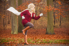 Fashion woman running in fall autumn park forest. Royalty Free Stock Photos