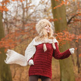 Fashion woman running in fall autumn park forest. Stock Photo