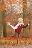 Fashion woman running in fall autumn park forest. Stock Images