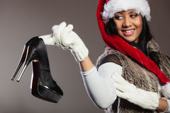 Fashion woman in santa hat with high heel shoe.. Royalty Free Stock Photo