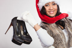 Fashion woman in santa hat with high heels shoes. royalty free stock image