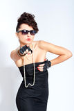Fashion woman in sexy dress and sunglasses Stock Photo