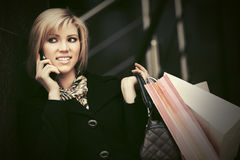 Fashion woman with shopping bags calling on cell phone Stock Photos