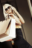 Fashion woman with shopping bags calling on mobile phone Royalty Free Stock Photography
