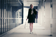 Fashion woman with shopping bags walking in the mall Royalty Free Stock Photo