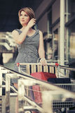 Fashion woman with shopping cart in the mall Royalty Free Stock Photo