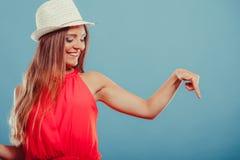 Fashion woman showing blank empty copyspace. Royalty Free Stock Image