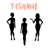 Fashion woman silhouette in tight dresses Royalty Free Stock Photos
