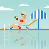 Fashion woman sitting with coconut cocktail at the edge of swimming pool with deck chair and umbrella Stock Images