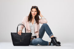 Fashion woman sitting Stock Image