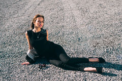 Fashion woman sitting on the road Stock Photo