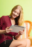 Fashion woman sitting on sofa with pc tablet. Royalty Free Stock Photography