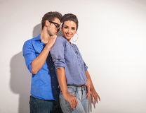 Fashion woman smiling while her lover is behind her. Royalty Free Stock Photo
