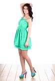 Fashion woman standing  in green dress Royalty Free Stock Image