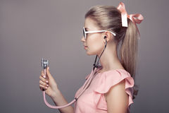 Fashion woman with stethoscope in hand. Stock Image