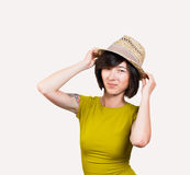 Fashion woman in straw hat Stock Images