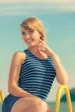 Fashion woman in striped dress outdoor. Summer. Royalty Free Stock Photography