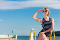 Fashion woman in striped dress outdoor. Summer. Stock Photography