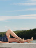 Fashion woman in striped dress outdoor. Summer. Sensual fashion woman girl in striped dress relaxing outdoor. Summer Royalty Free Stock Photo