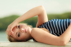 Fashion woman in striped dress outdoor. Summer. Stock Photo