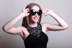 Fashion woman in a stylish glasses Royalty Free Stock Images