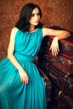 Fashion woman with suitcases Royalty Free Stock Photo
