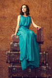 Fashion woman with suitcases Stock Photos