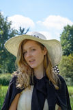 Fashion woman with summer hat. Fashion smiling woman with summer hat in nature Stock Photography
